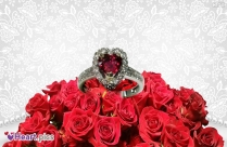 Heart Shape Engagement Ring On Rose Image